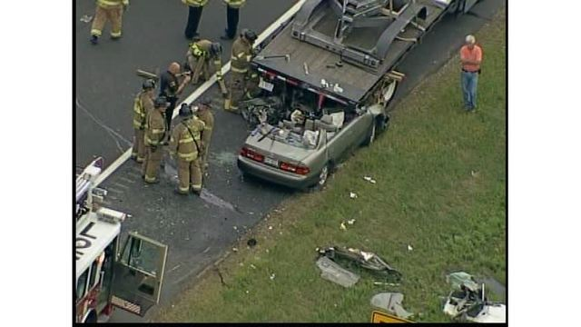 Car shears off roof after slamming into flat-bed truck in Charlotte