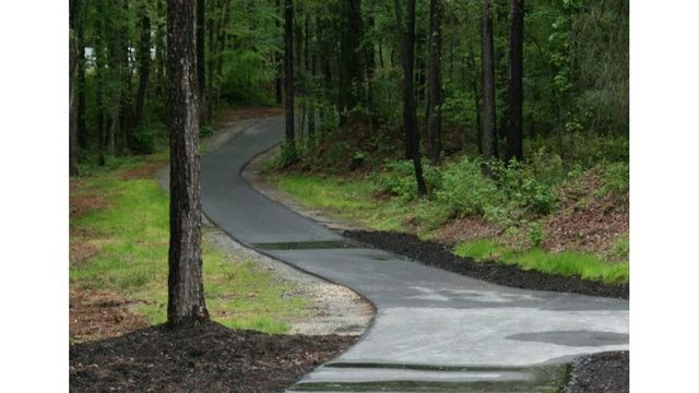 Woman attacked and raped while walking along Fayetteville trail, police say